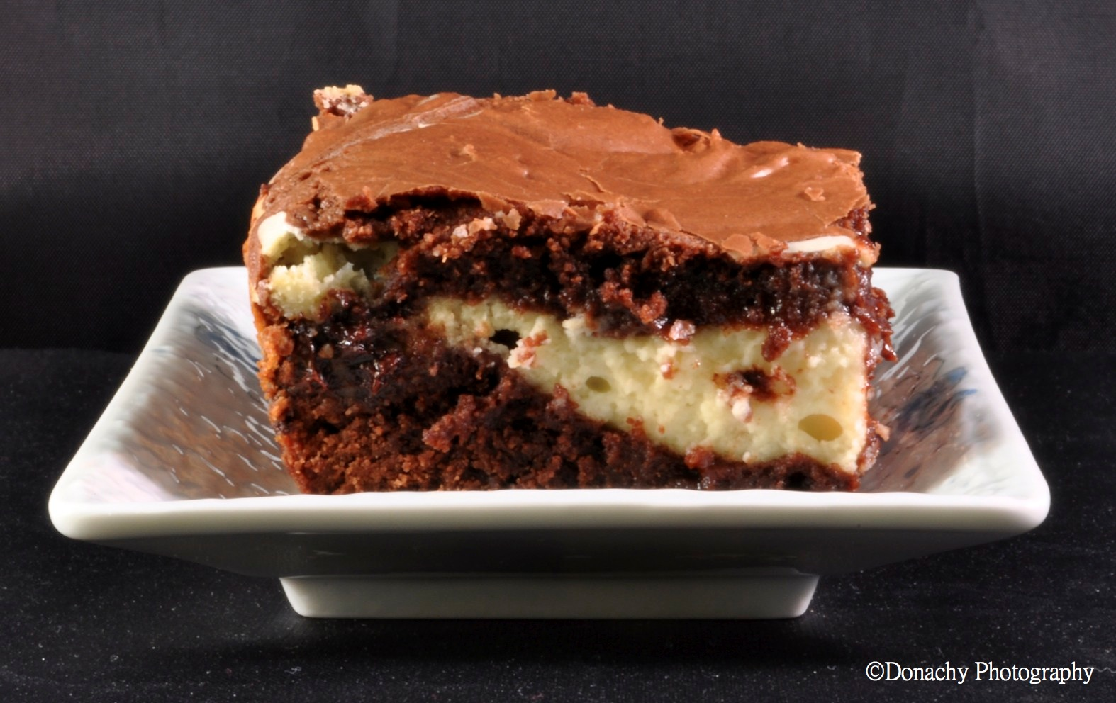 Fudge-like brownie batter swirled with chocolate chip cheesecake make ...